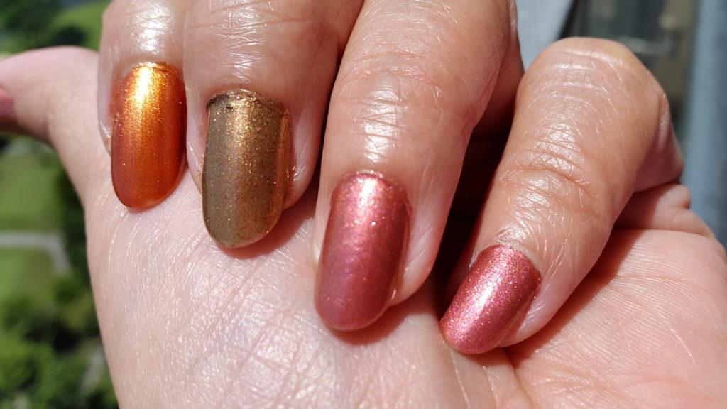 Colorbar 24 Carat Nail Lacquer - 009 Brick Gold, 001 Liquid Gold, 004 Pinken Gold for comparison